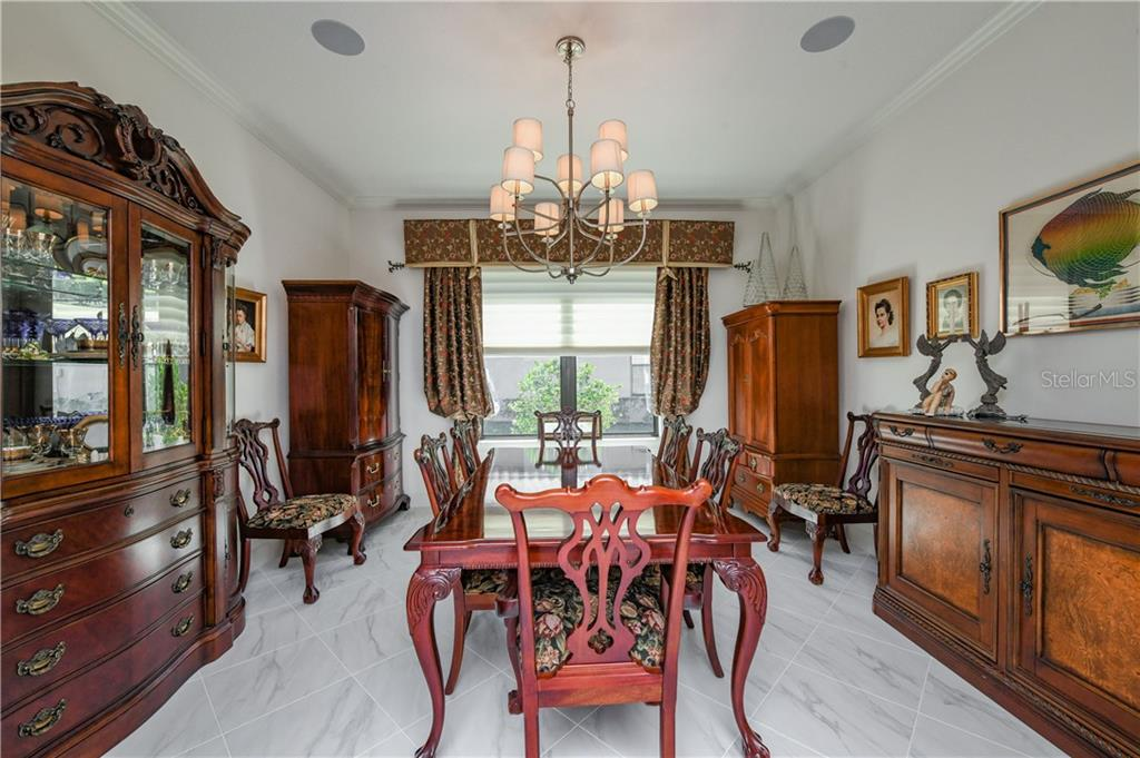Study/Den currently being used as Dining Room - Single Family Home for sale at 4827 Cabreo Ct, Bradenton, FL 34211 - MLS Number is A4429726