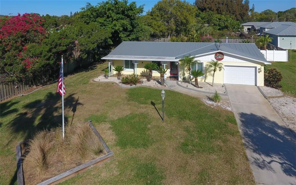 Great curb appeal.  Surrounded by high-end waterfront homes. - Single Family Home for sale at 310 Bayview Pkwy, Nokomis, FL 34275 - MLS Number is A4430065