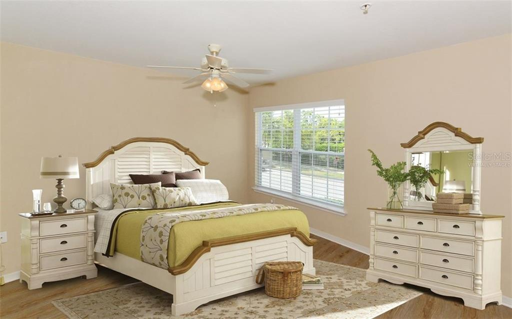 Bedroom furnishings have been virtually staged. - Condo for sale at 5701 Soldier Cir #204, Sarasota, FL 34233 - MLS Number is A4430587