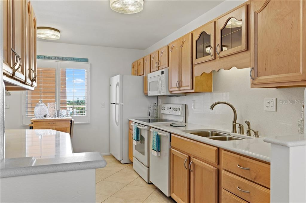 Condo for sale at 5300 Gulf Dr #406, Holmes Beach, FL 34217 - MLS Number is A4430634