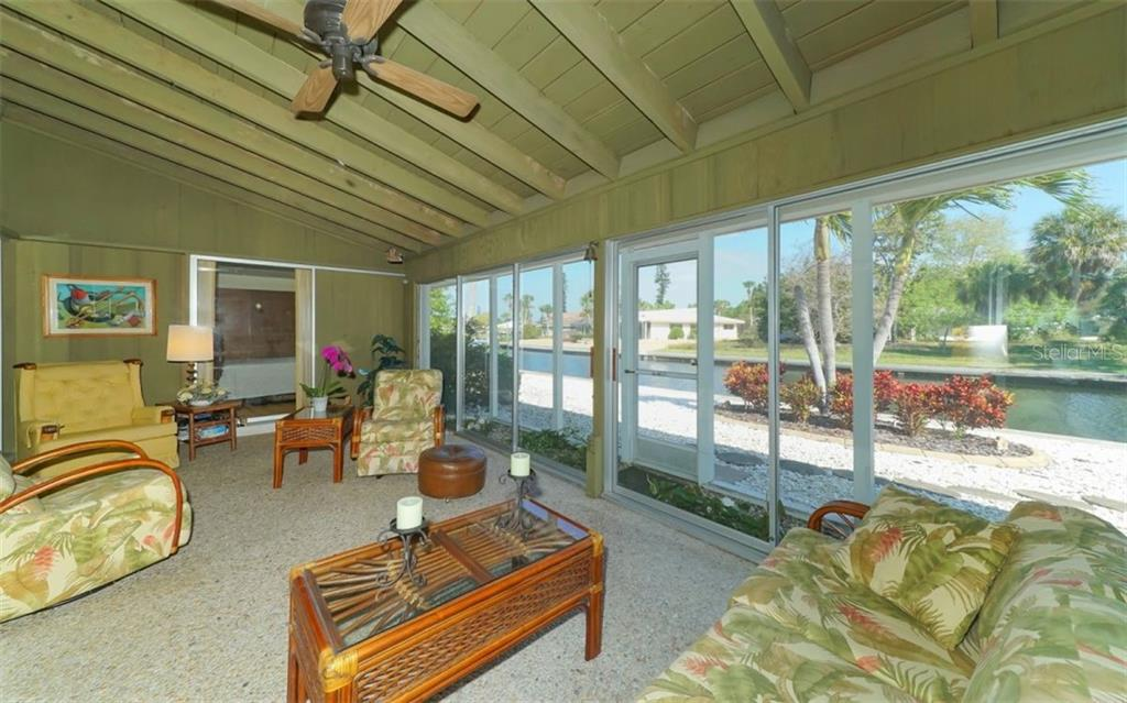 Enjoy lovely canal views from the Florida room - Single Family Home for sale at 935 Contento St, Sarasota, FL 34242 - MLS Number is A4431223