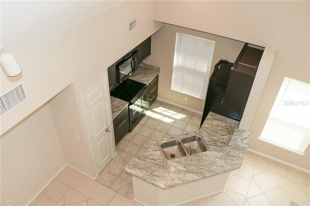 View down from Loft of Kitchen - Condo for sale at 5511 Rosehill Rd #201, Sarasota, FL 34233 - MLS Number is A4431621