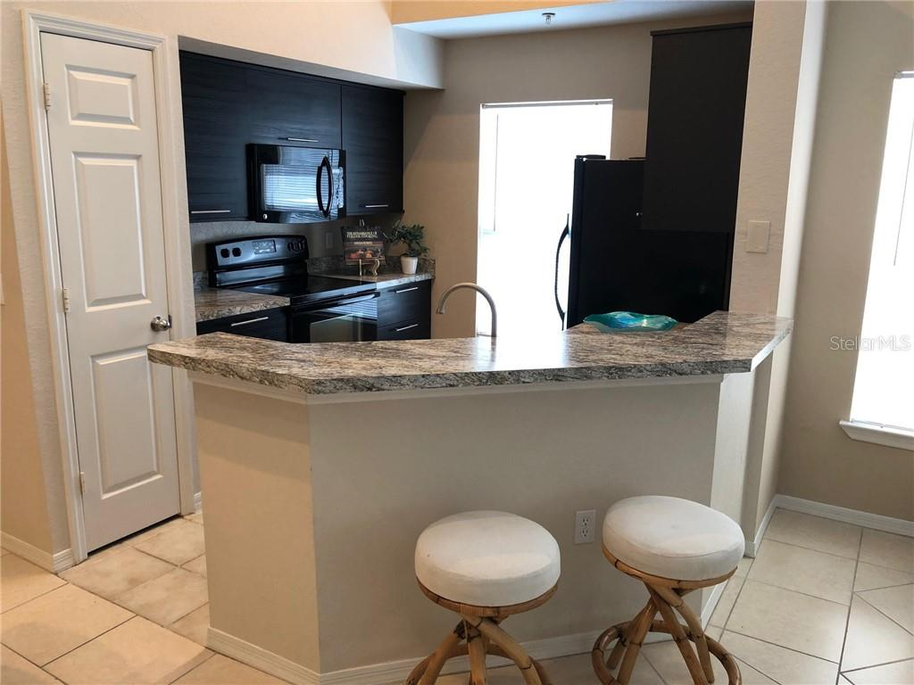 Breakfast Bar Facing Kitchen - Condo for sale at 5511 Rosehill Rd #201, Sarasota, FL 34233 - MLS Number is A4431621