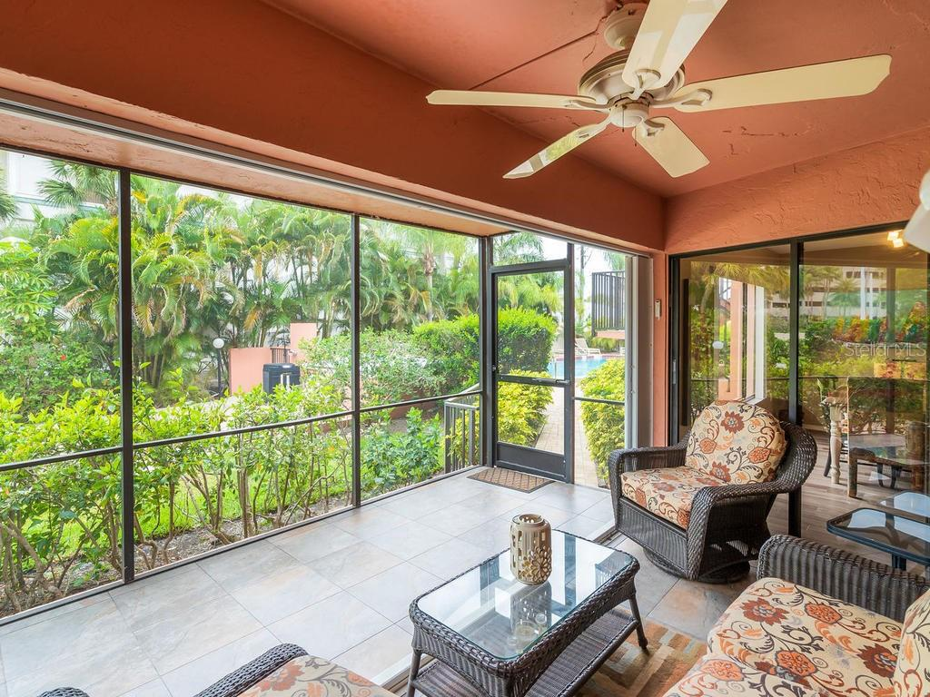 Roomy screened-in lanai with tile floors steps away from the swimming pool - Condo for sale at 131 Garfield Dr #1b, Sarasota, FL 34236 - MLS Number is A4432013