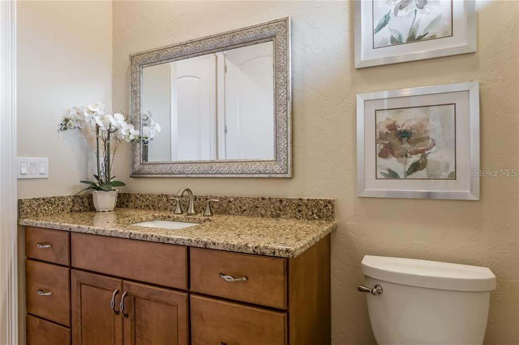 The third bathroom features granite counter tops and high-end fixtures. - Single Family Home for sale at 19432 Newlane Pl, Bradenton, FL 34202 - MLS Number is A4432094