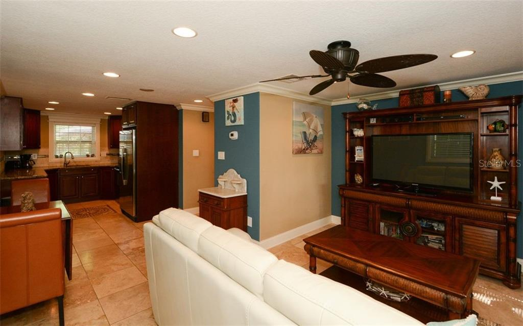 Living room and kitchen for 5290 - Duplex/Triplex for sale at 5290 Avenida Navarra, Sarasota, FL 34242 - MLS Number is A4432152