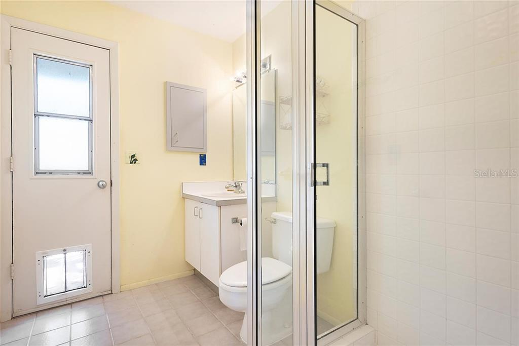 Additional Bathroom with exterior access. - Single Family Home for sale at 1302 Roberts Bay Ln, Sarasota, FL 34242 - MLS Number is A4433097