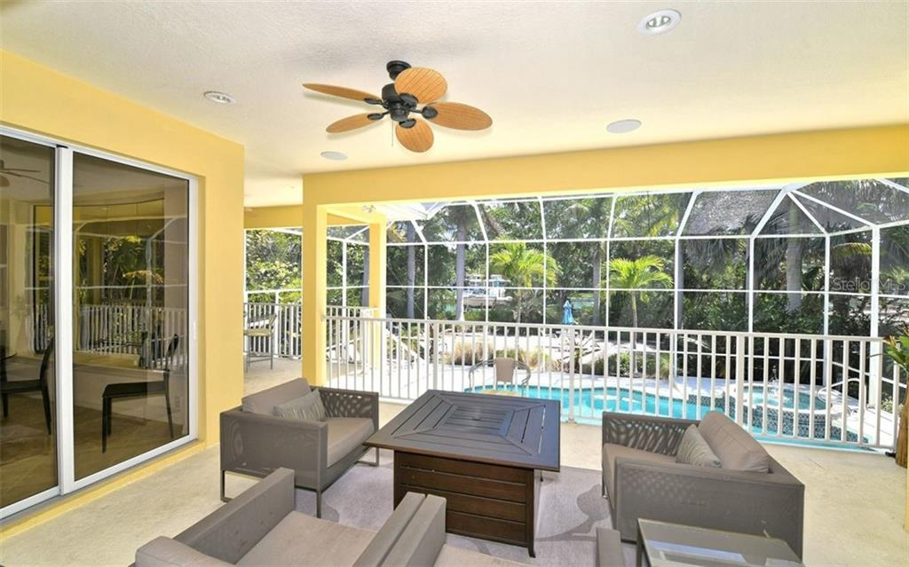 Outdoor seating with fire pit table - Single Family Home for sale at 3525 White Ln, Sarasota, FL 34242 - MLS Number is A4433441