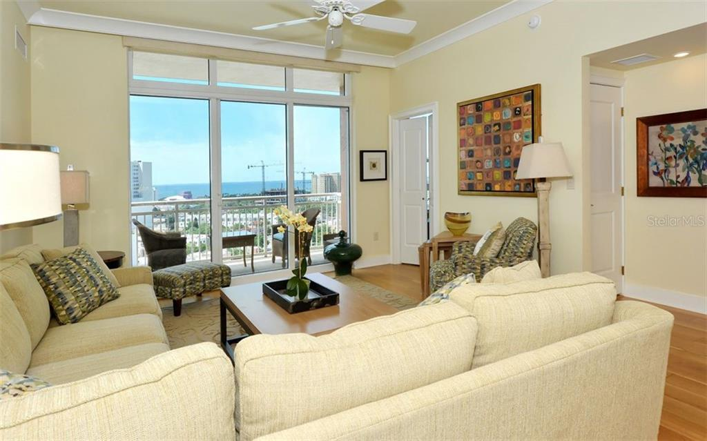 The guest room is off the living room - Condo for sale at 1350 Main St #1500, Sarasota, FL 34236 - MLS Number is A4433444