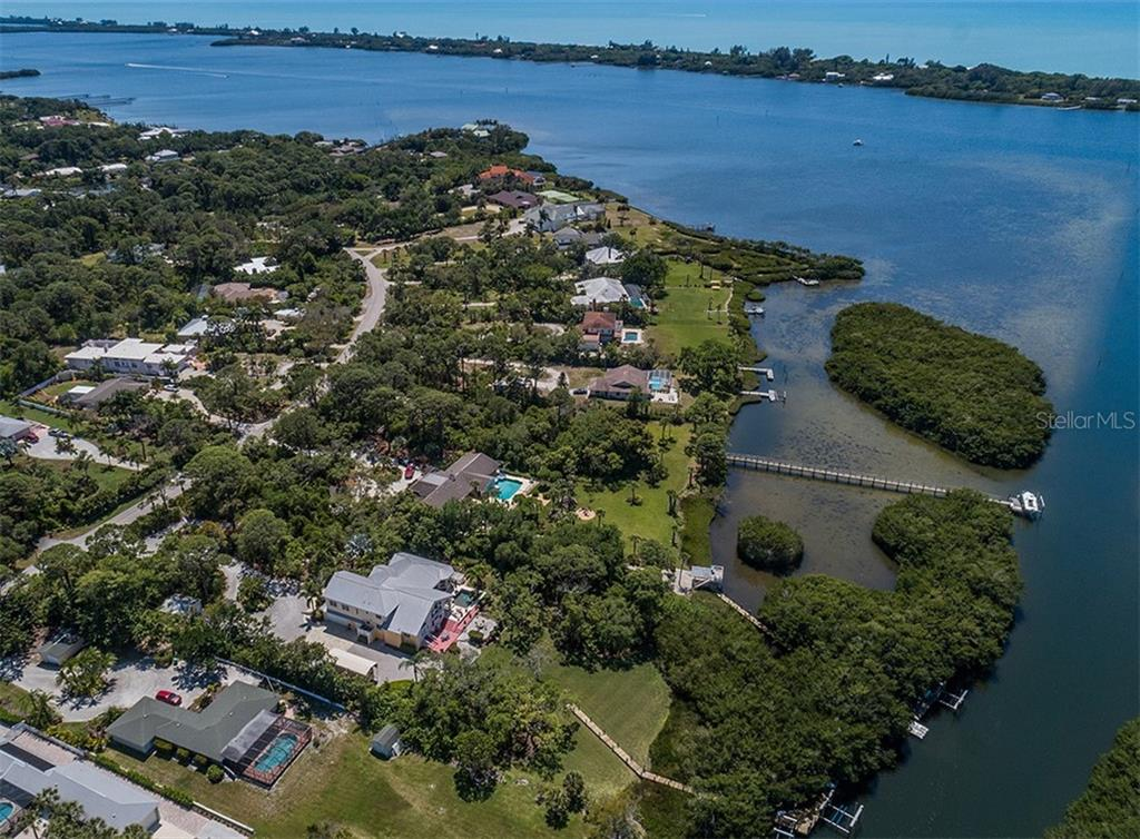 Aerial - Southern view of Intracoastal Waterway / Lemon Bay and Gulf of Mexico.  Boaters