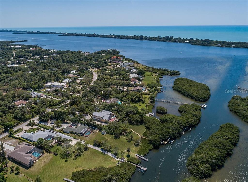 Aerial - Forked Creek - Dock and 2 boat lifts - Single Family Home for sale at 1361 Bayshore Dr, Englewood, FL 34223 - MLS Number is A4433943