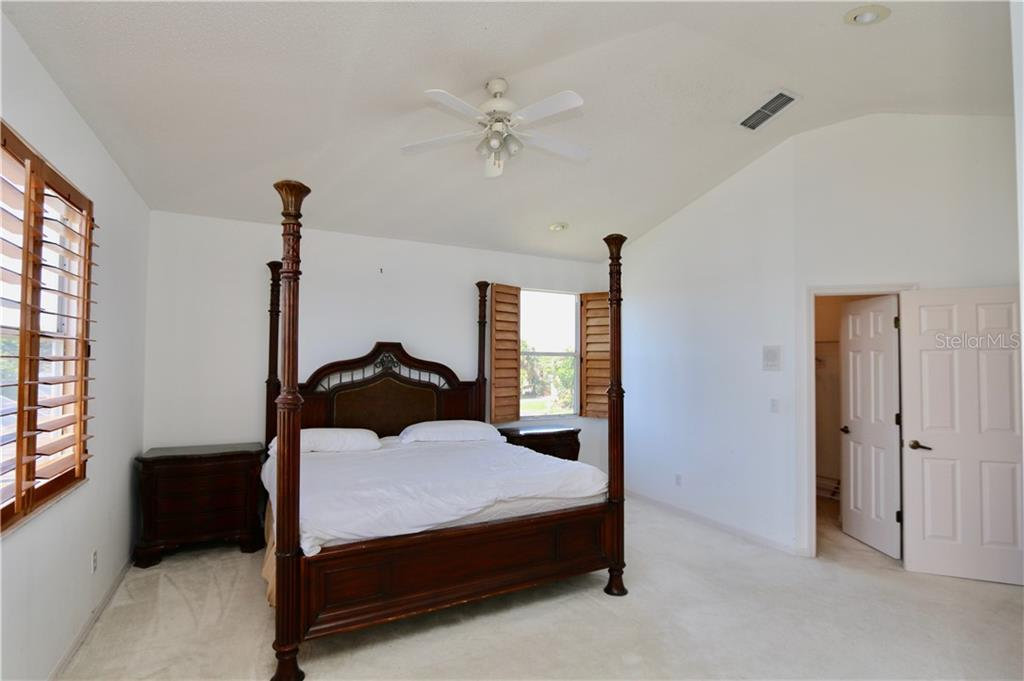 Master bedroom with walk-in closet - Single Family Home for sale at 5082 47th St W, Bradenton, FL 34210 - MLS Number is A4435806