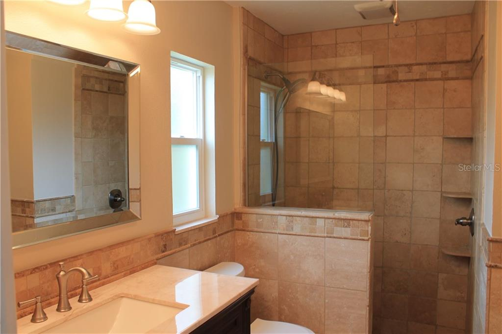 Complete master bath remodel.  Exhaust fan, ceiling fan, very light and bright. - Single Family Home for sale at 4803 Glenbrooke Dr, Sarasota, FL 34243 - MLS Number is A4435920