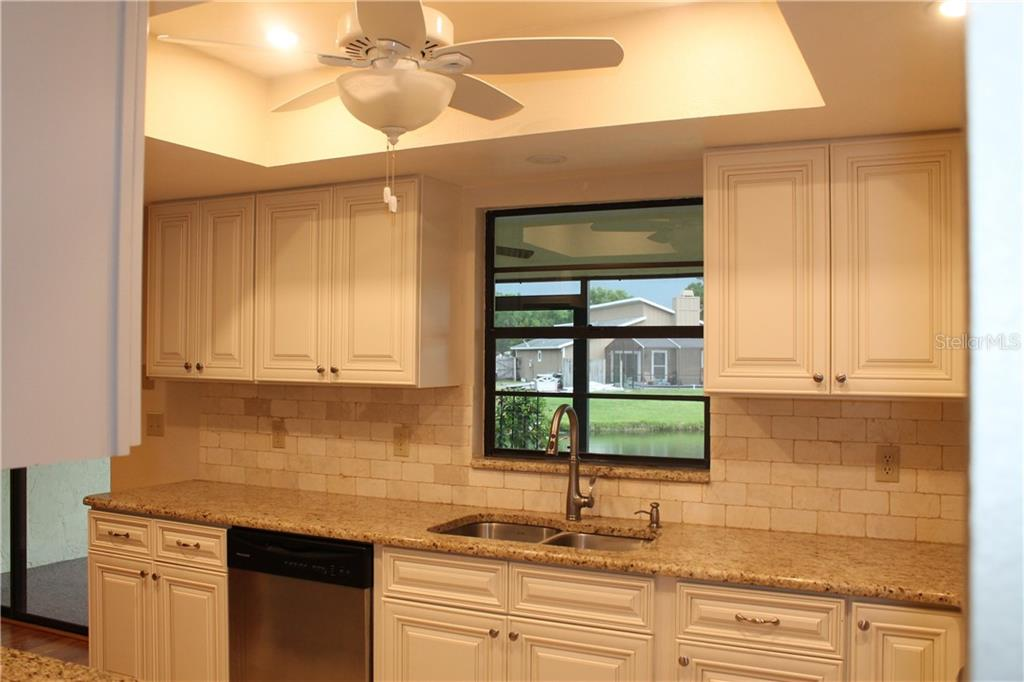 This window opens to the lanai with an extended granite space shelf, a nice added touch. Over looking the pond. - Single Family Home for sale at 4803 Glenbrooke Dr, Sarasota, FL 34243 - MLS Number is A4435920