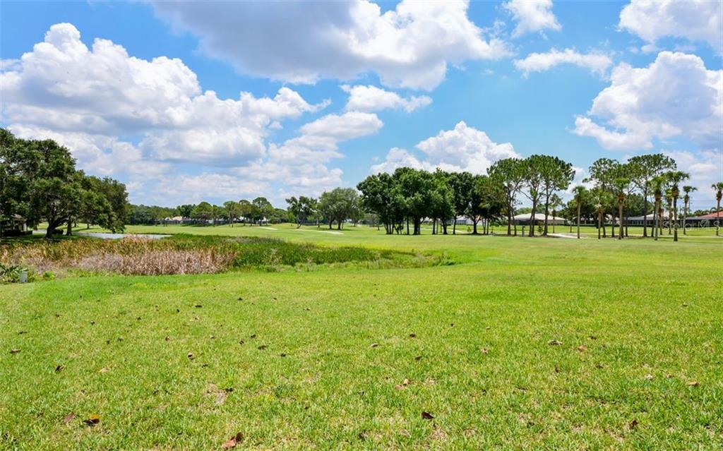 Forever view across the golf course...close enough to enjoy but not so close as to interrupt your privace - Single Family Home for sale at 5401 Downham Meadows, Sarasota, FL 34235 - MLS Number is A4436577