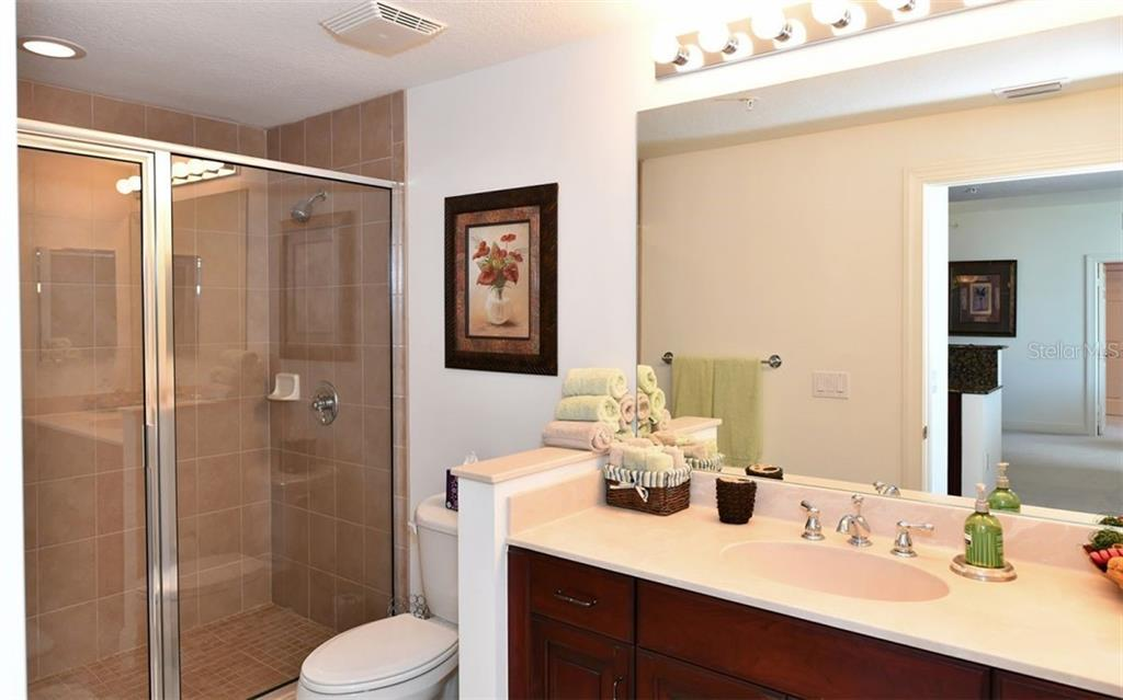 Guest bath with walk-in shower - Condo for sale at 800 N Tamiami Trl #602, Sarasota, FL 34236 - MLS Number is A4436915
