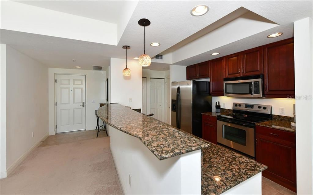 Room for eating at the kitchen island - Condo for sale at 800 N Tamiami Trl #602, Sarasota, FL 34236 - MLS Number is A4436915