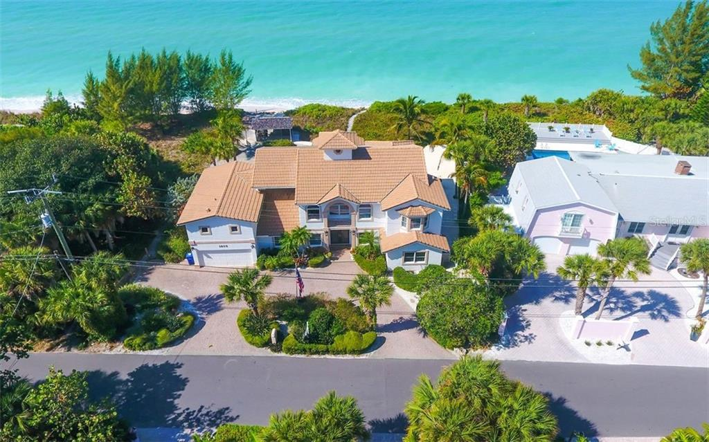 Aerial Front - Single Family Home for sale at 3809 Casey Key Rd, Nokomis, FL 34275 - MLS Number is A4437924