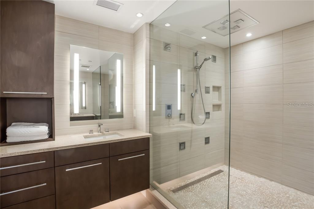Master Bathroom and shower. - Condo for sale at 301 Beach Rd #301-1, Sarasota, FL 34242 - MLS Number is A4438015