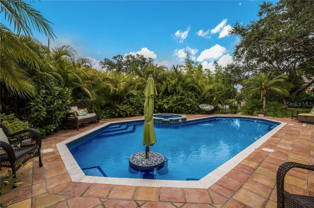 Single Family Home for sale at 7303 Periwinkle Dr, Sarasota, FL 34231 - MLS Number is A4438156
