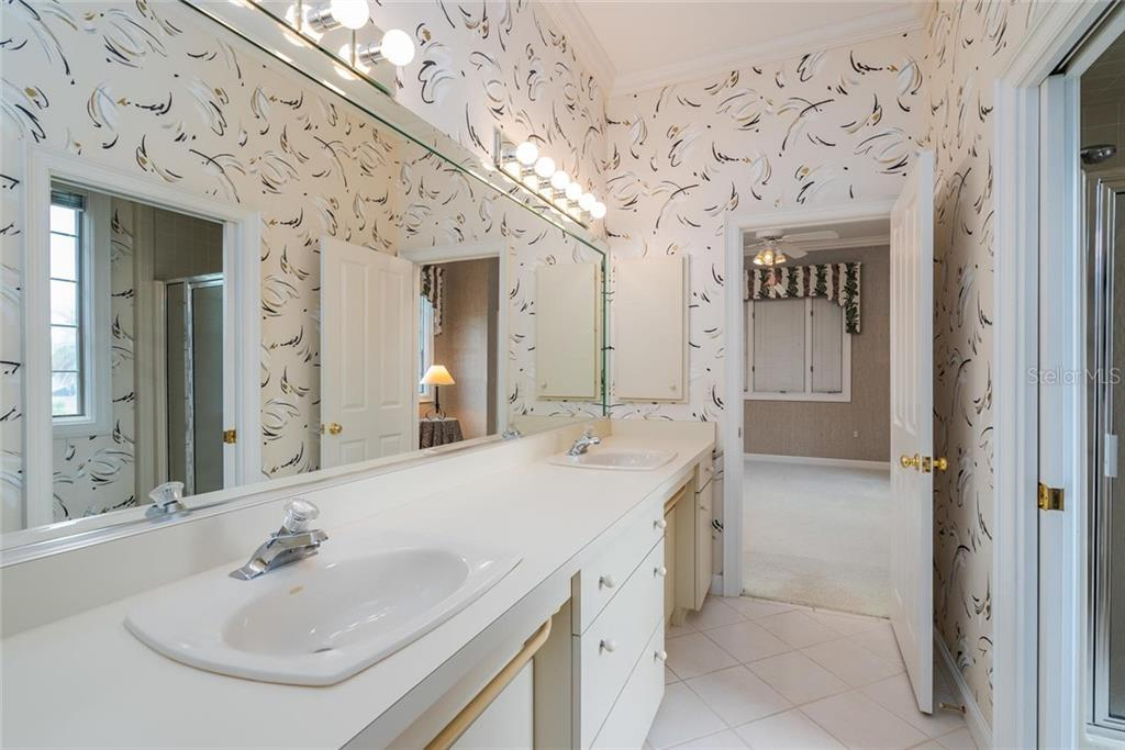 Jack 'n Jill Guest Bathroom - accessible from Guest bedrooms #2 & #3 with privacy pocket door to W/C and shower. - Single Family Home for sale at 3702 Beneva Oaks Blvd, Sarasota, FL 34238 - MLS Number is A4438878