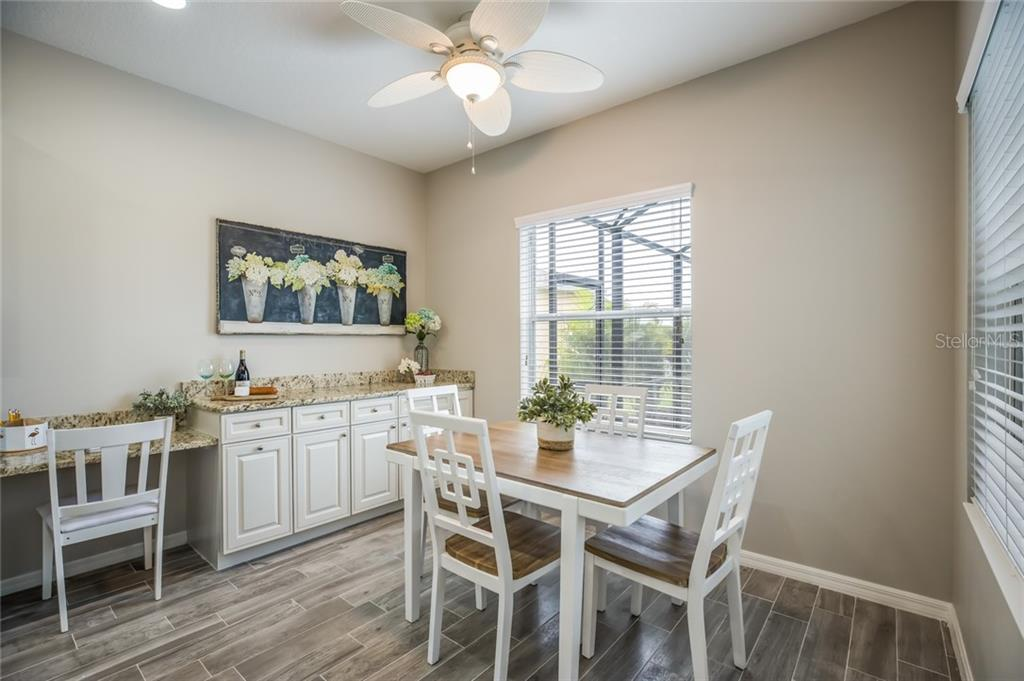 Eating space in the kitchen with custom built ins - Single Family Home for sale at 12255 Longview Lake Cir, Lakewood Ranch, FL 34211 - MLS Number is A4439342
