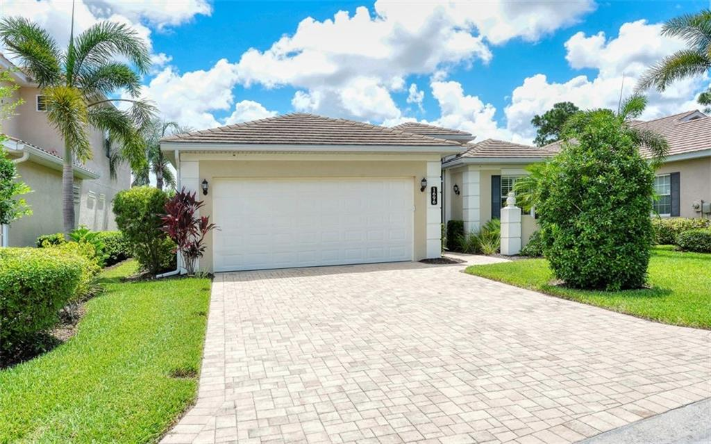 Front of residence with Paver Brick driveway - Single Family Home for sale at 1696 Lancashire Dr, Venice, FL 34293 - MLS Number is A4441325