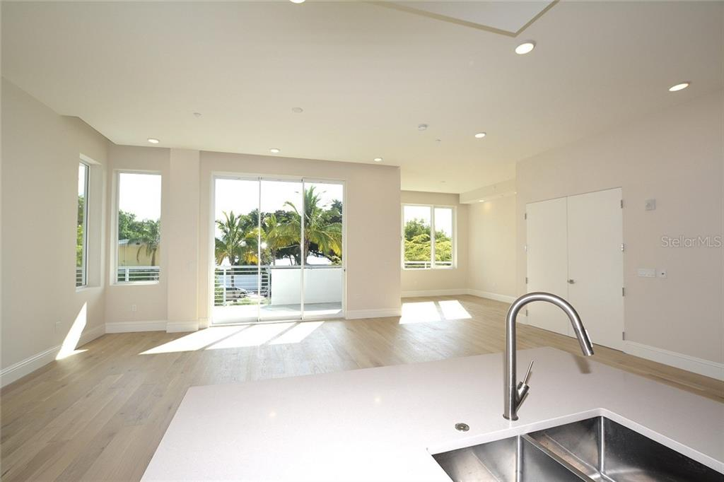 The kitchen offers Eurotech cabinetry and Jenn-Air appliances with gas cooktop. - Condo for sale at 609 Golden Gate Pt #202, Sarasota, FL 34236 - MLS Number is A4441802