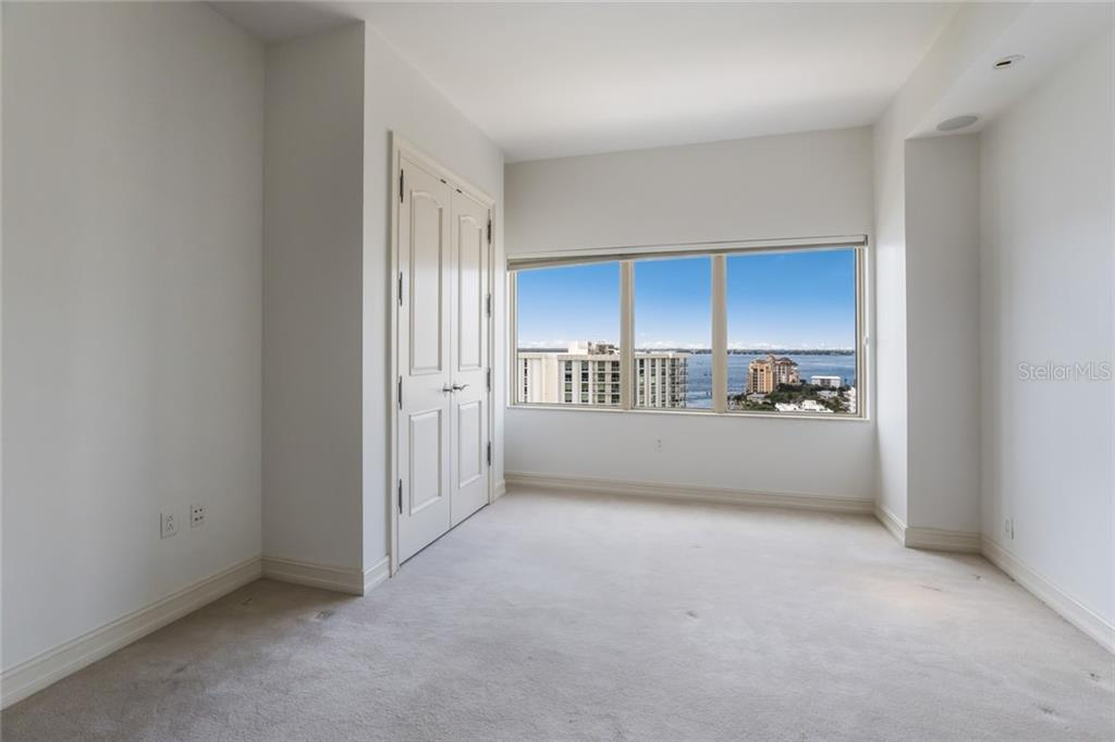 The third bedroom is light and bright with a gorgeous view of the bay over Golden Gate Point. - Condo for sale at 1111 Ritz Carlton Dr #1704, Sarasota, FL 34236 - MLS Number is A4442192