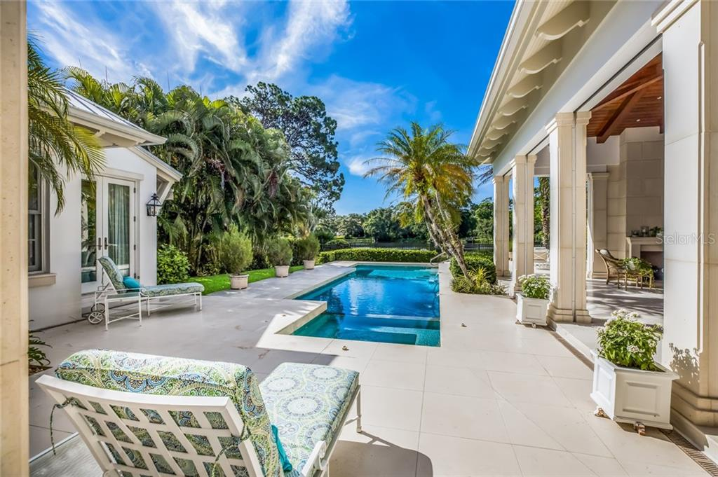 In ground spa and lap pool - Single Family Home for sale at 1522 N Lake Shore Dr, Sarasota, FL 34231 - MLS Number is A4442286