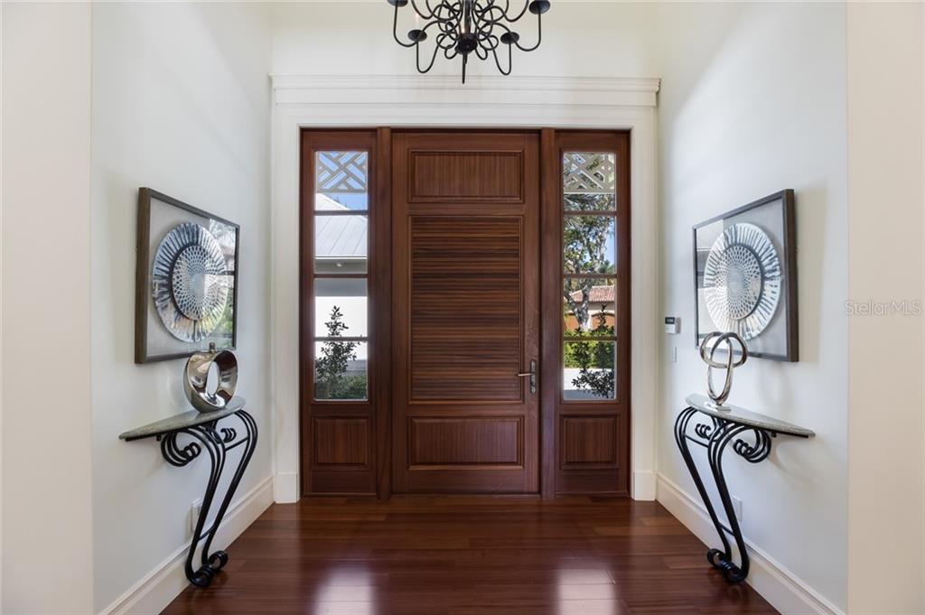 Solid Mahogany front entry door - Single Family Home for sale at 1522 N Lake Shore Dr, Sarasota, FL 34231 - MLS Number is A4442286