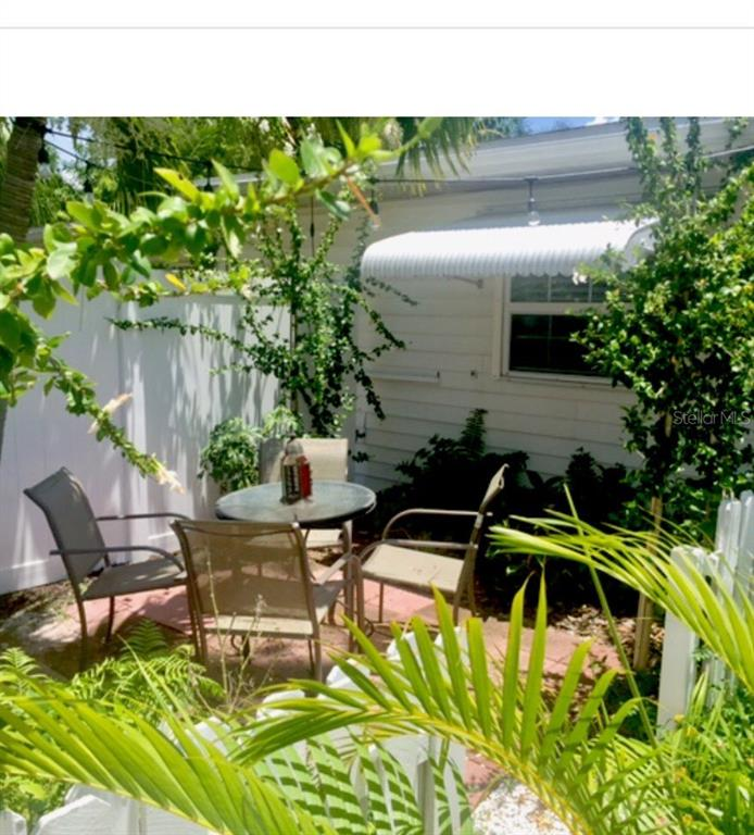 Private Patio area surrounded by gardens and fence - Duplex/Triplex for sale at 4418-4420 100th St W, Bradenton, FL 34210 - MLS Number is A4443821