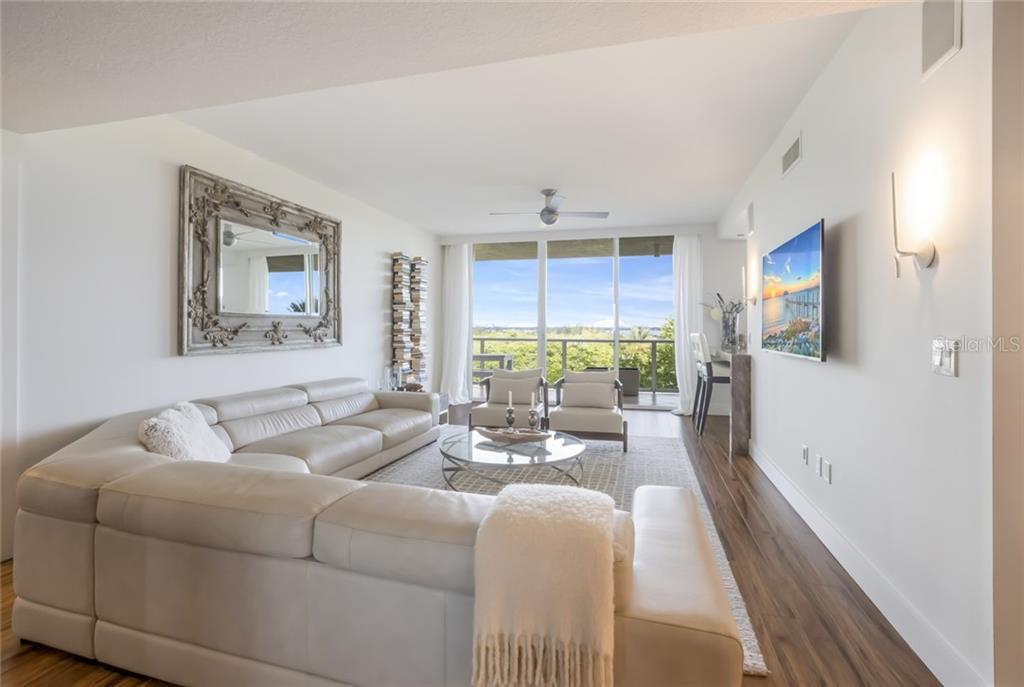 Open Living Room with Bay & City views - Condo for sale at 1800 Benjamin Franklin Dr #b408, Sarasota, FL 34236 - MLS Number is A4444789
