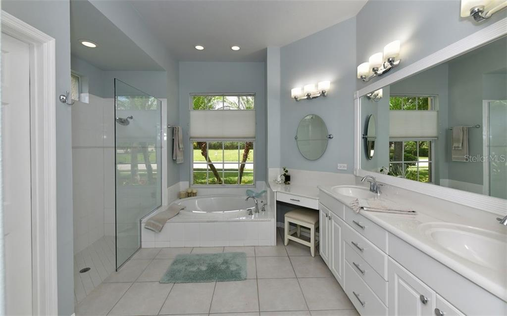New oval mirror and double vanity - Single Family Home for sale at 13022 Peregrin Cir, Bradenton, FL 34212 - MLS Number is A4444939