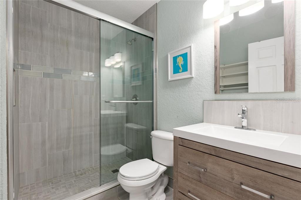 Seal Bathroom. - Single Family Home for sale at 523 Beach Rd, Sarasota, FL 34242 - MLS Number is A4446354