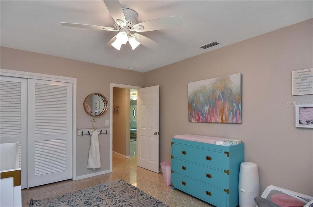 Bedroom 2 - Single Family Home for sale at 105 Alba St E, Venice, FL 34285 - MLS Number is A4446473