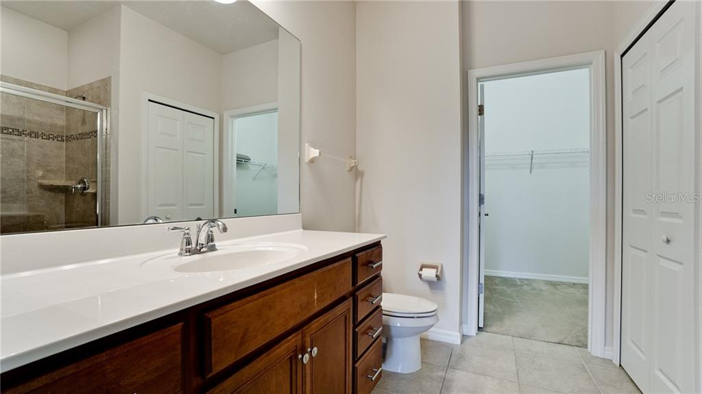 Owner's bath features a single bowl sink and large under-counter storage plus a medicine cabinet. Large linen closet and walk in shower - Condo for sale at 7815 Moonstone Dr #24-204, Sarasota, FL 34233 - MLS Number is A4446867