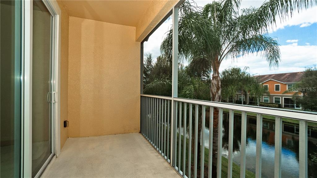 relax on your screen lanai and watch the turtles and wildlife - Condo for sale at 7815 Moonstone Dr #24-204, Sarasota, FL 34233 - MLS Number is A4446867