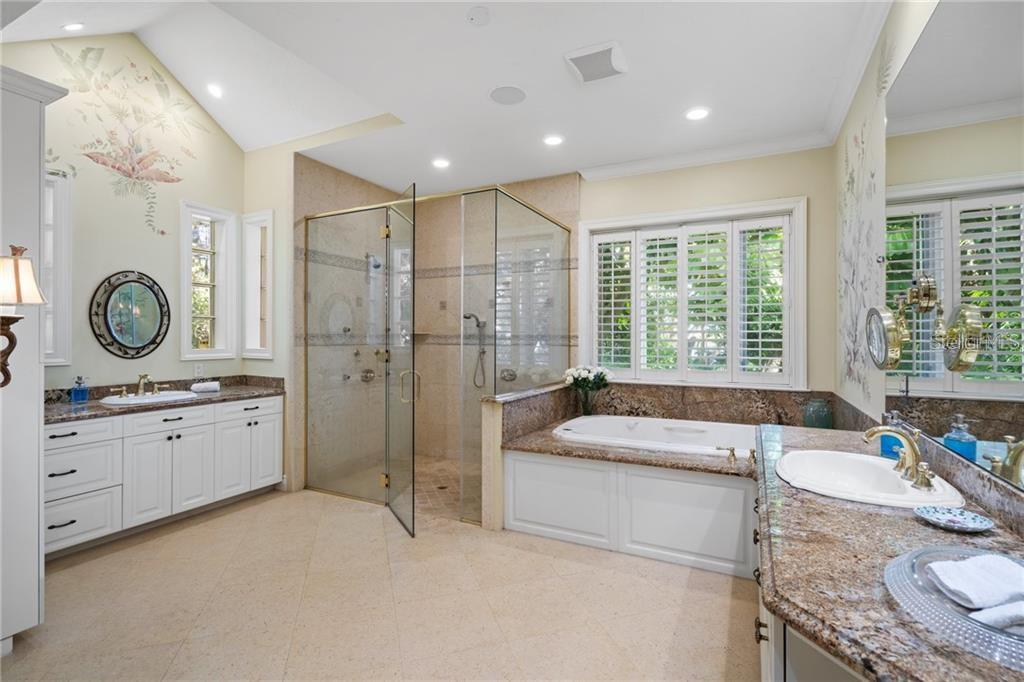 Huge first floor master bath with toilet closet and large walk in closet. - Single Family Home for sale at 711 Mangrove Point Rd, Sarasota, FL 34242 - MLS Number is A4447637