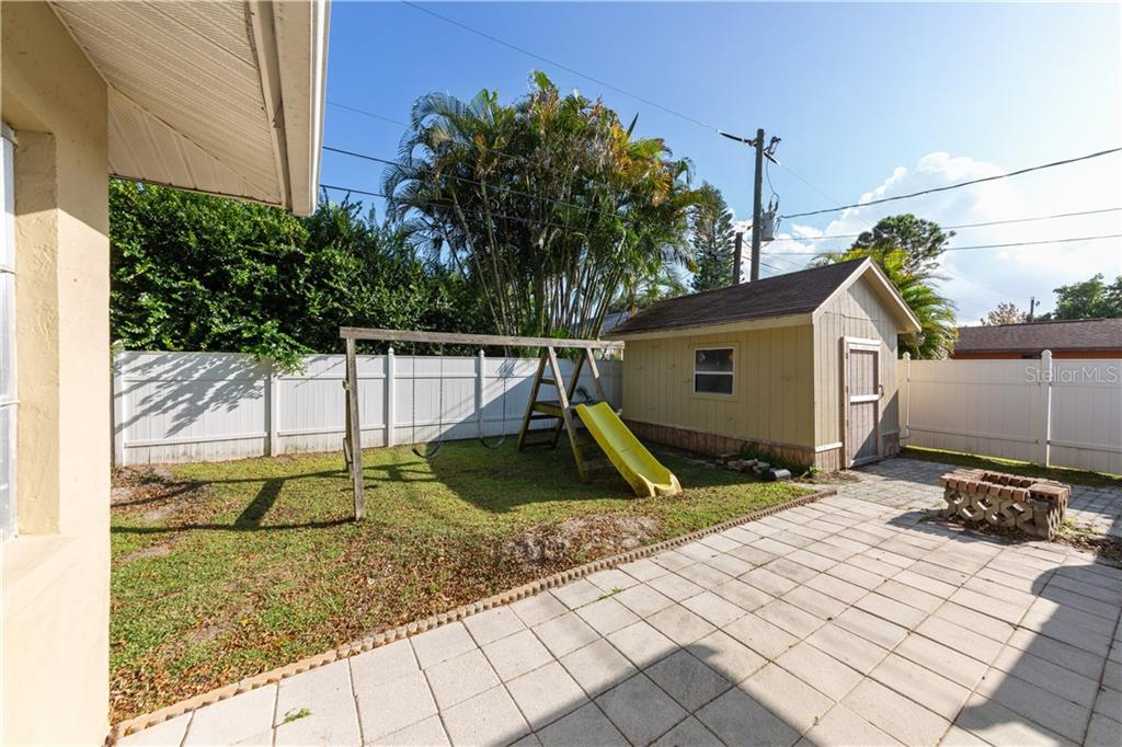 Fenced backyard with storage shed - Duplex/Triplex for sale at 311 Coronado Rd, Venice, FL 34293 - MLS Number is A4449208