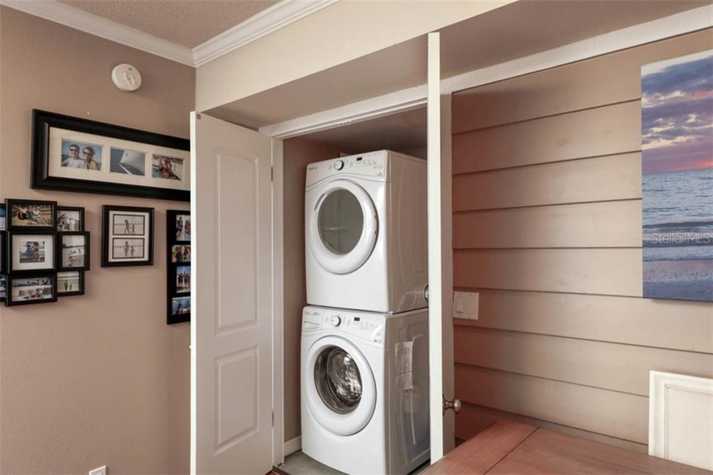 full size stacked washer and dryer inside large closet - Condo for sale at 5855 Midnight Pass Rd #332, Sarasota, FL 34242 - MLS Number is A4450019