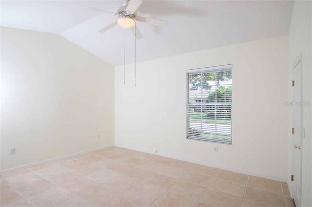 Master bedroom offers pool view and access - Single Family Home for sale at 6620 Hunter Combe Xing, University Park, FL 34201 - MLS Number is A4450282