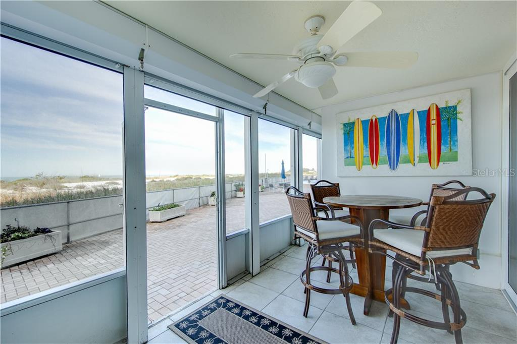 Another view of your screened lanai.  Please note that the furniture and wall art do not convey. - Condo for sale at 555 The Esplanade N #102, Venice, FL 34285 - MLS Number is A4450635