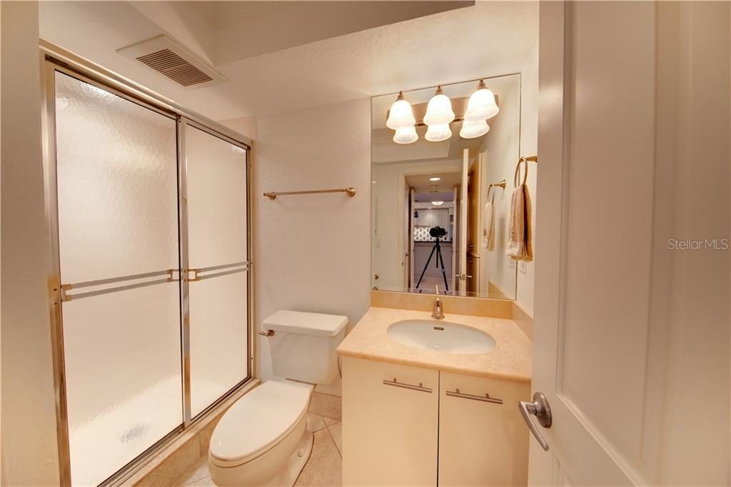 View of the guest bathroom. - Condo for sale at 555 The Esplanade N #102, Venice, FL 34285 - MLS Number is A4450635