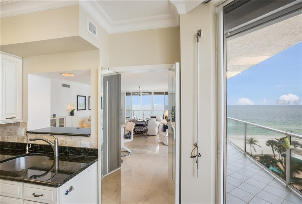 Sneak peak of wrap around terrace reaching all the way to kitchen. - Condo for sale at 1800 Benjamin Franklin Dr #b506, Sarasota, FL 34236 - MLS Number is A4451047