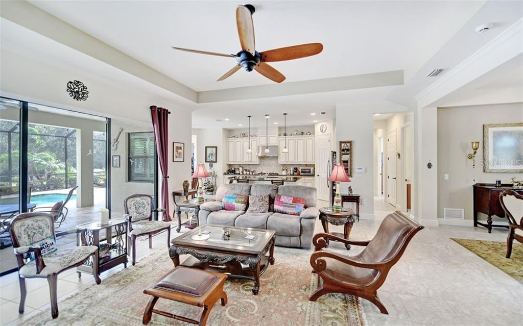 Light, bright living space...note the high ceilings! - Single Family Home for sale at 8260 Larkspur Cir, Sarasota, FL 34241 - MLS Number is A4455087