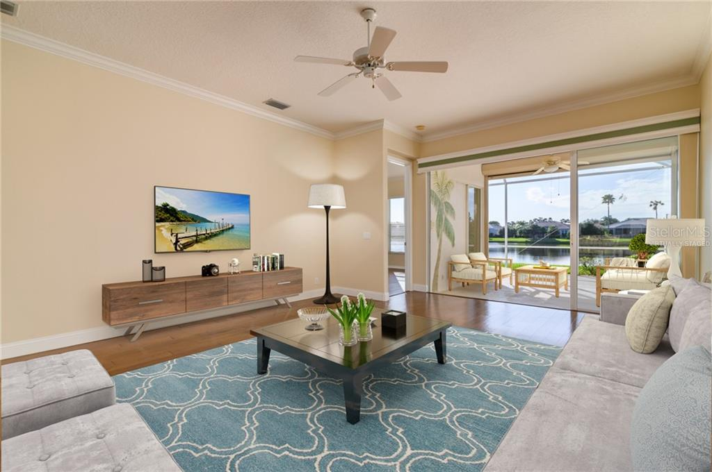 Living Room Virtually Staged - Villa for sale at 4560 Samoset Dr, Sarasota, FL 34241 - MLS Number is A4455487