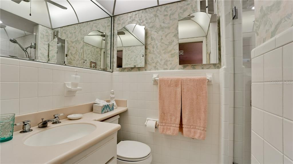 THIS IS THE EN SUITE IN THE MASTER BEDROOM BUT BOTH BATHROOMS WERE UPDATED WITH NEW GLASS SHOWER DOORS, NEW FIXTURES, SINK, LIGHTING & RETILED. - Condo for sale at 6700 Gulf Of Mexico Dr #116, Longboat Key, FL 34228 - MLS Number is A4456442