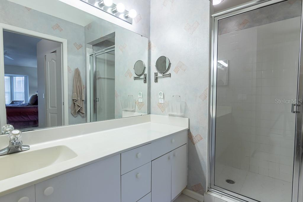 Master bath walk-in shower and vanity - Condo for sale at 9570 High Gate Dr #1722, Sarasota, FL 34238 - MLS Number is A4457005