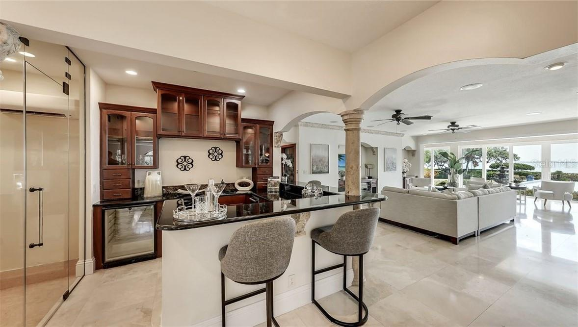 Family Room Has Been Virtually Staged. - Single Family Home for sale at 5372 Sandhamn Pl, Longboat Key, FL 34228 - MLS Number is A4458496